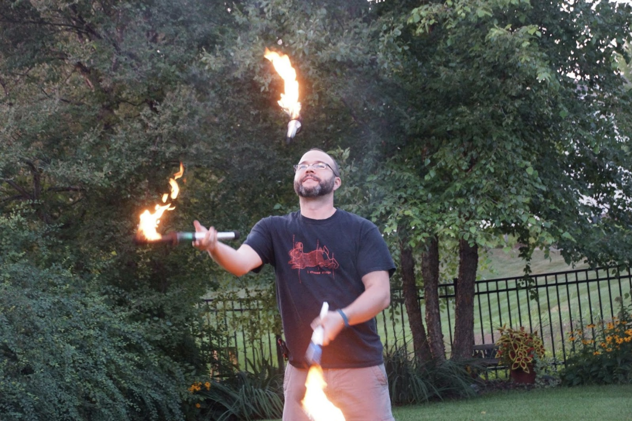 Auth0 Senior Solutions Architect Carlos Mostek fire juggling""