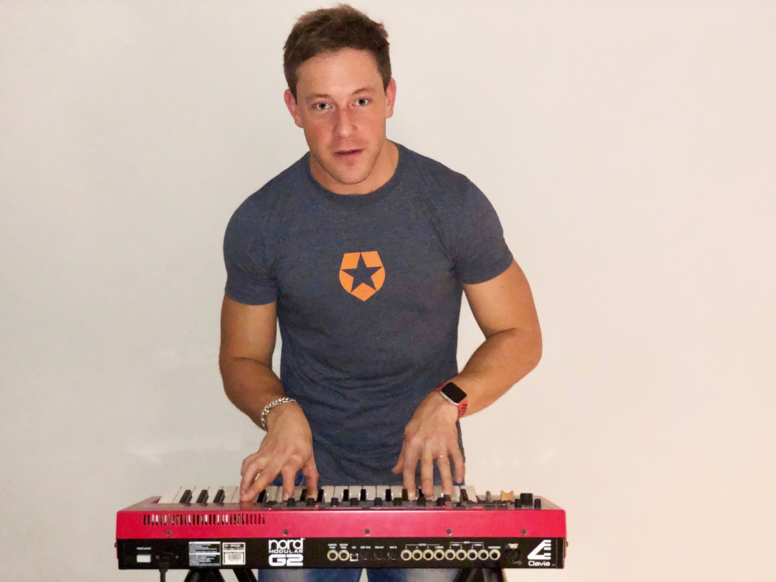 Auth0 Customer Success Architect Julian Lywood-Mulcock playing piano