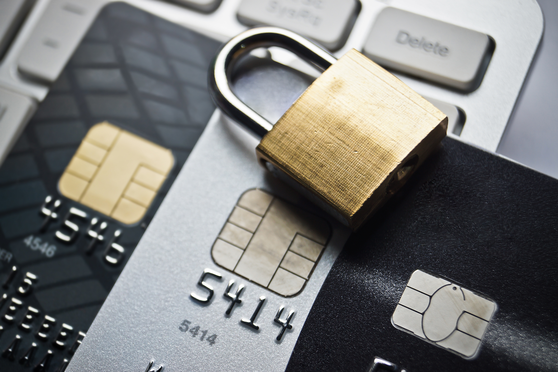 Image of a credit card secured by a lock